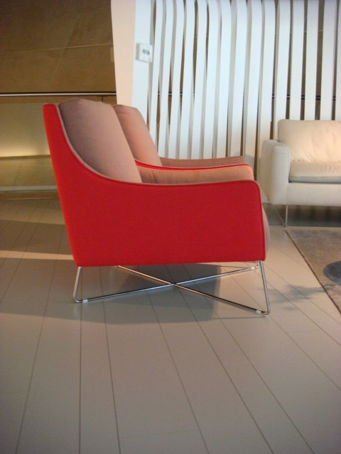 The Shanghai armchair by Italsofa boasts cherry-red fabric and seemingly delicate metal base.  High Point Market 2011 by Diana Budds