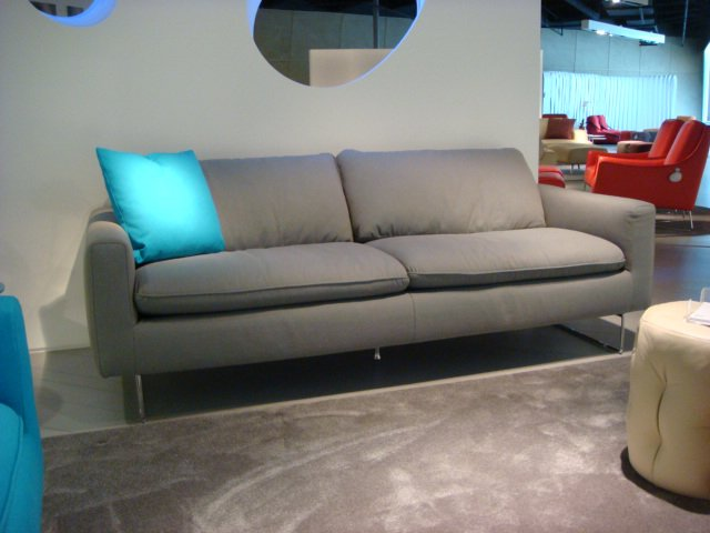 The color of the season? Grey (not Honeysuckle). From the contemporary brands to the more traditional, grey was ubiquitous. Shown here is Italsofa's Spades model.  High Point Market 2011 by Diana Budds