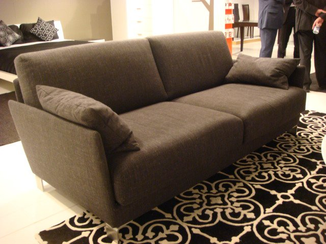 Charcoal grey over at Calligaris. This is their small-space-friendly Timeless two-seater sofa.  High Point Market 2011 by Diana Budds