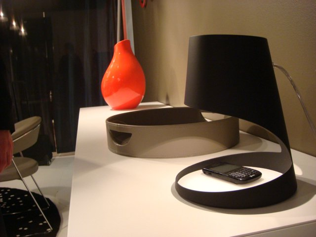 Italian design house Calligaris delved into lighting design this year, and their recent foray proved to be quite fruitful. The Evo nightstand lamp designed by Armando D'Andrea features a ring-shaped base, which is meant to be a place to stash a phone, keys, or other small items that easily become misplaced.  High Point Market 2011 by Diana Budds