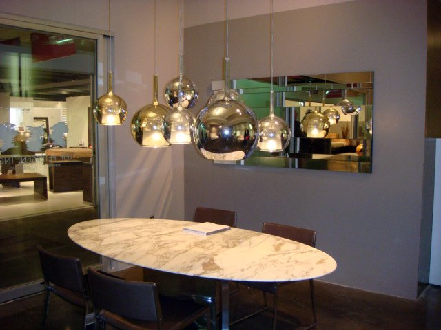 An arrangement of Penta lamps illuminate the Leif Petersen showroom.  High Point Market 2011 by Diana Budds