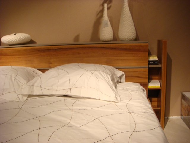 The headboard of the Riade bed by Gautier features a slide-out bookshelf.  High Point Market 2011 by Diana Budds
