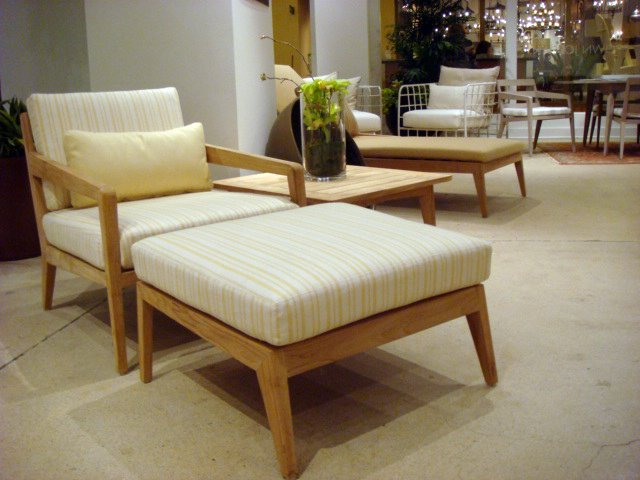 The recently-released Drift Collection by Brown Jordan features plantation-grown teak frames that will weather with time. Shown here are the lounge chair and ottoman.  High Point Market 2011 by Diana Budds