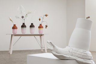 A view of the Snail table in situ, with Hella Jongerius's 'Artificial Vases' in the background.