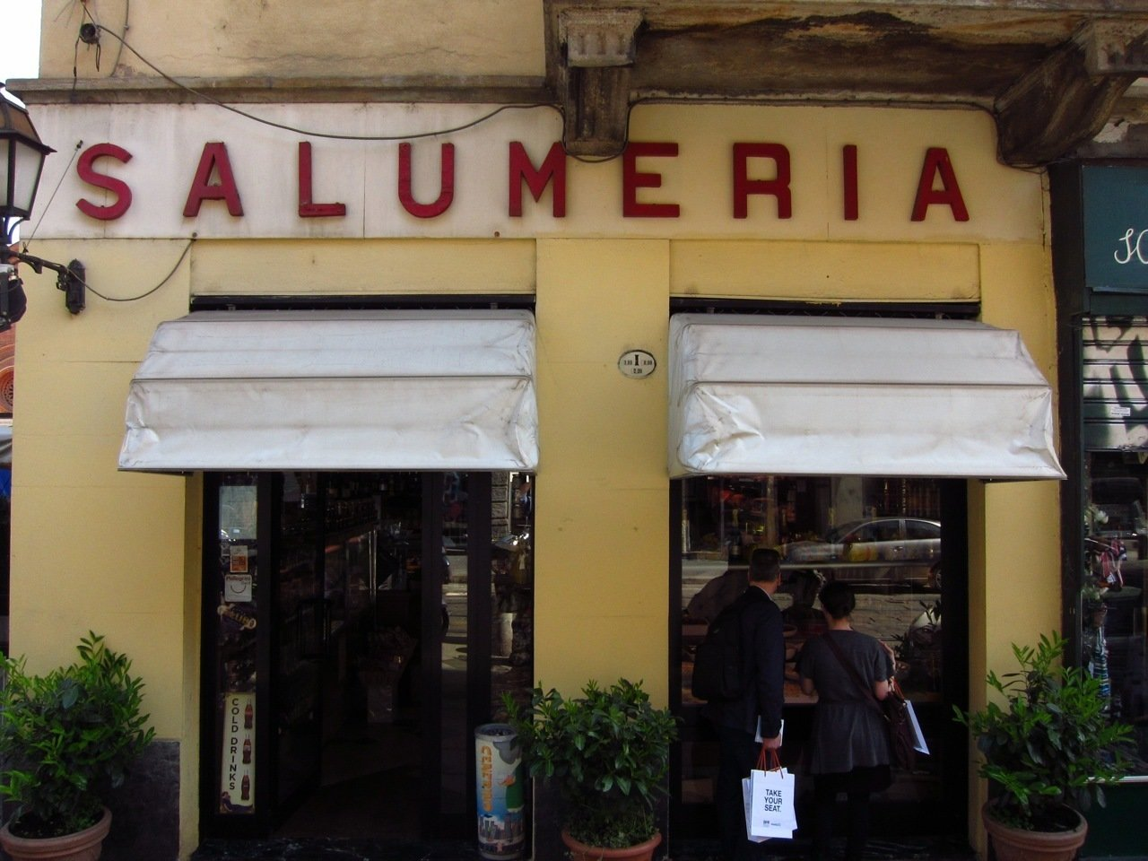 It was almost lunch hour, and along the Corso Garibaldi, Dwell's Amanda Dameron and Keven Weeks couldn't help but be seduced by a typical Salumeria.  Milan 2011: Day One by Amanda Dameron