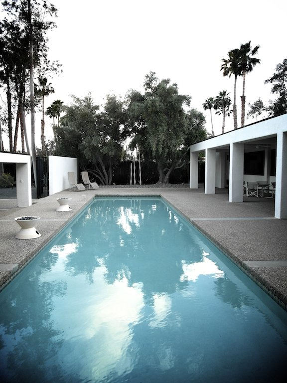 Here's another house we visited, a long white rectangle with a killer pool between the house and the street. Borrego Springs has lots of pools, but this one somehow seemed equally useful for swimming a few laps and lolling with a cocktail.  Modern Pool Design by Dwell from Borrego Springs' Mod Houses