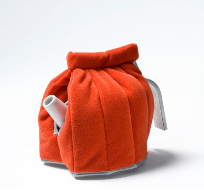 A bright orange tea cosy by Jongerius Lab.  Photo 4 of 7 in Friday Finds 4.15.11