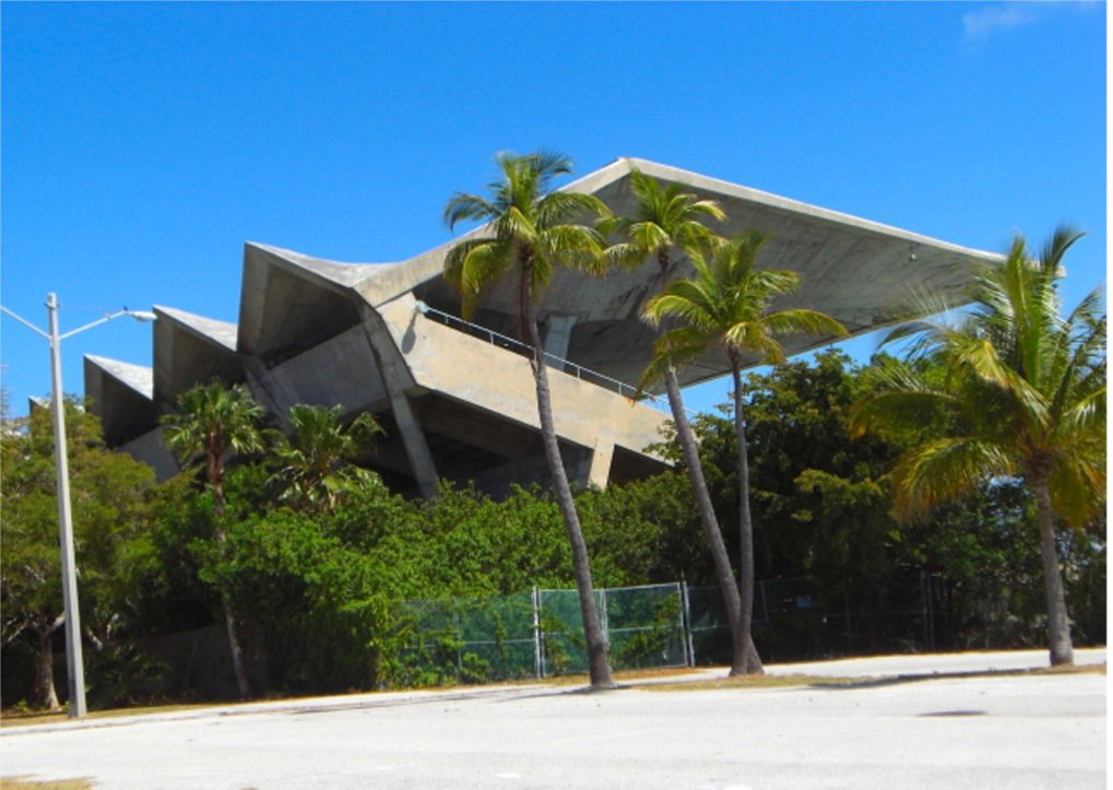 The view from stadium parking lot shows the dramatic roofline. Photo by Harry Emilio Gottlieb.  Preserving the Miami Marine Stadium by Rob Jordan