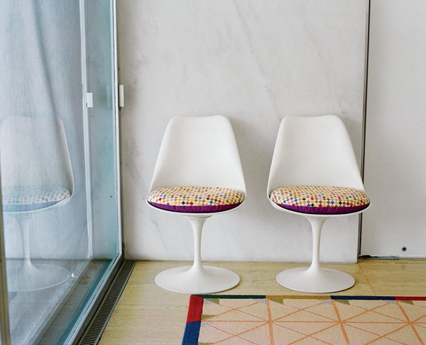 needlepoint seating pads on the Tulip chairs