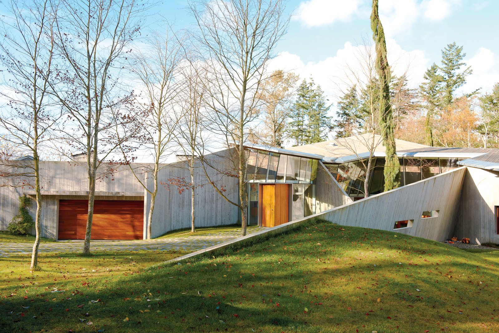 "Exterior, Concrete Siding Material, and House Building Type ""The house is a piece of origami made out of triangular shapes, which we then draped over the landscape,"" says Arbel.  23.2 House by Jordan Kushins"