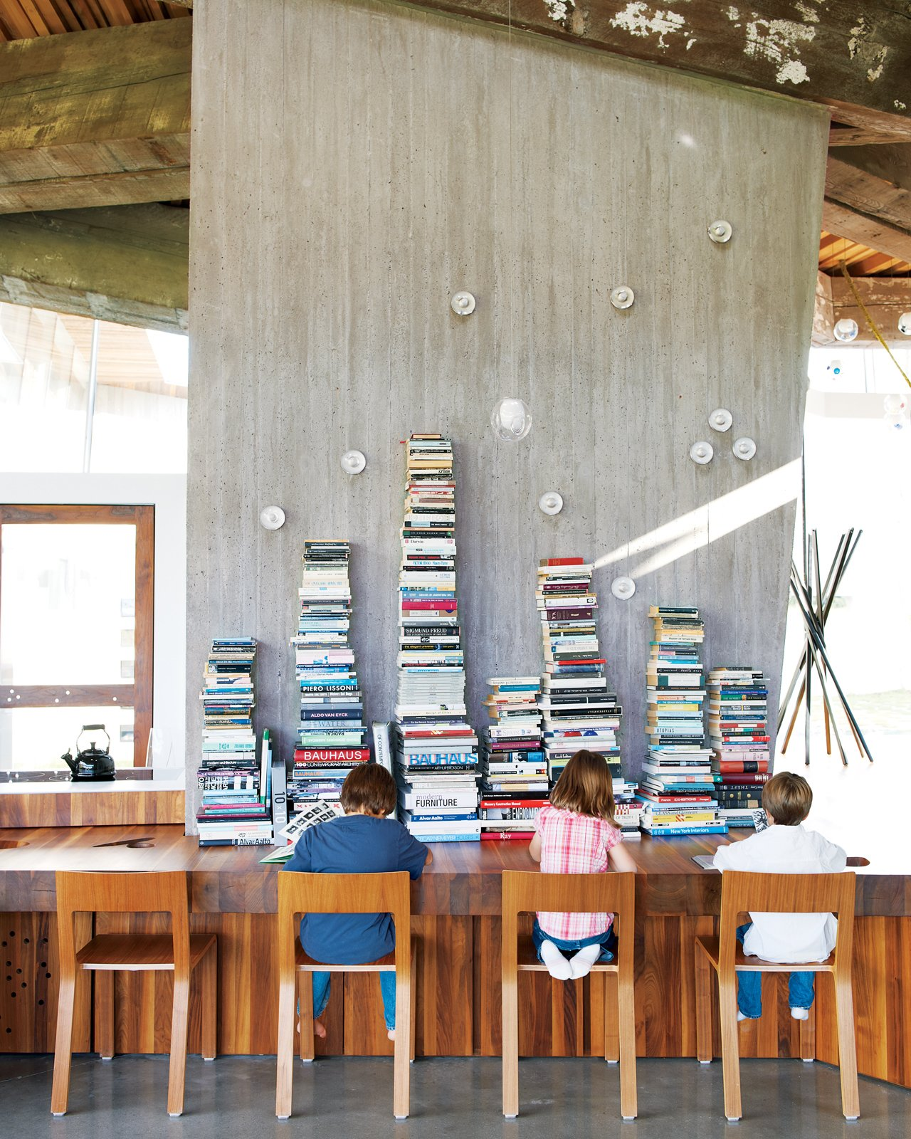 Dining Room, Table, Concrete Floor, and Chair Impromptu reading time in the open-plan kitchen is encouraged.  23.2 House by Jordan Kushins