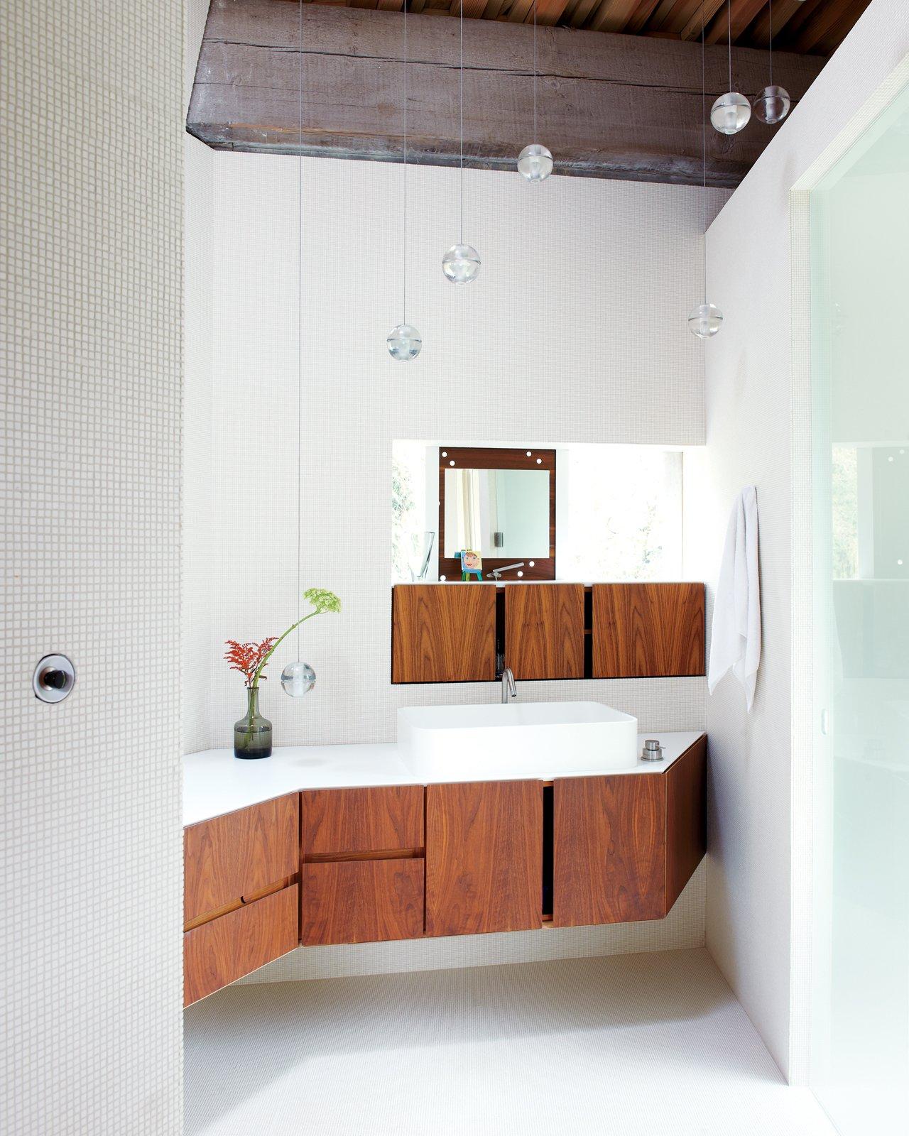 Bath Room, Wood Counter, and Vessel Sink White tiles envelop the en suite master bathroom.   23.2 House by Jordan Kushins