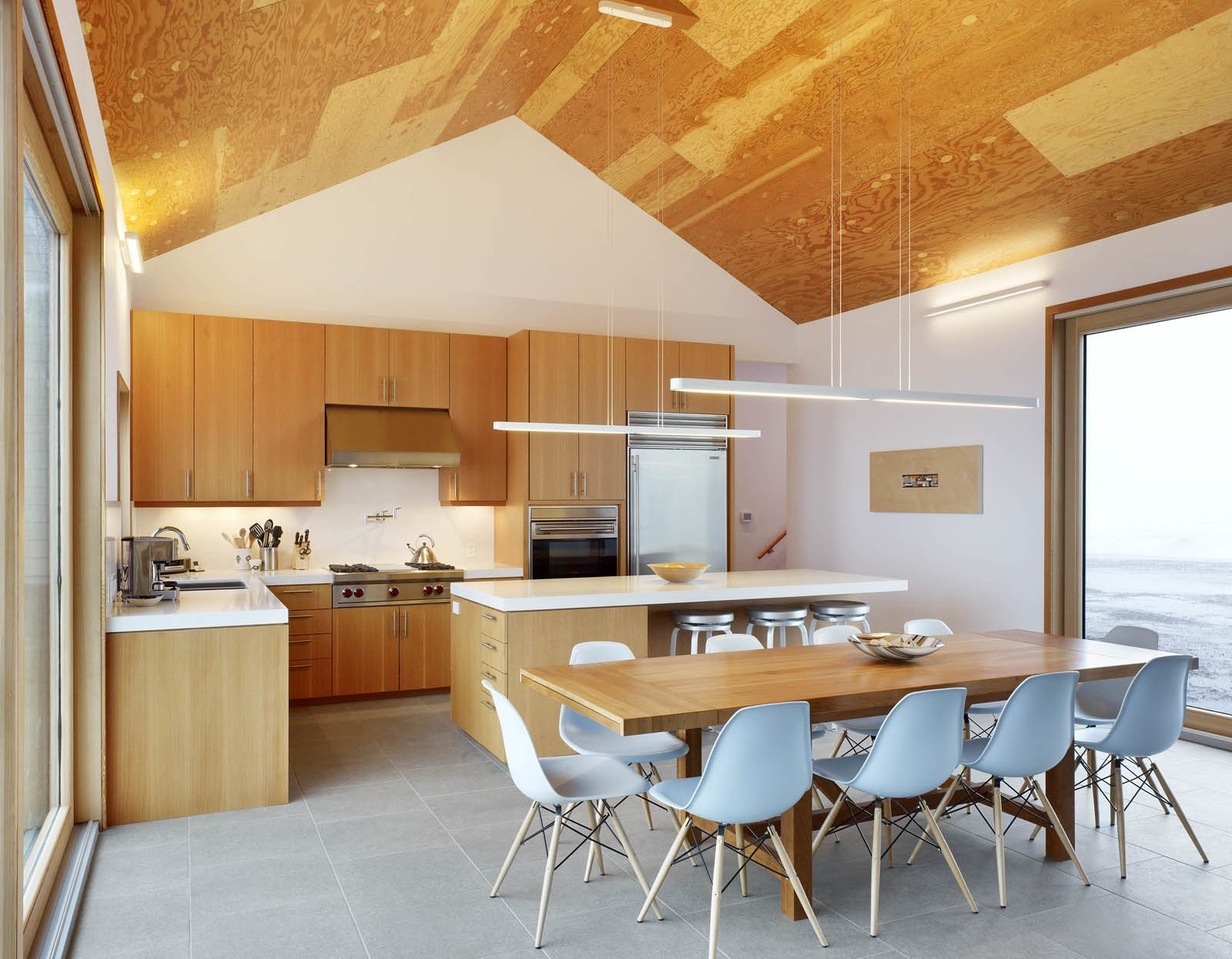 Rendely gave in and incorporated a more traditional gable roof but inside the house, which has been dubbed The Farm, it's all modern. Around the cherry dining room table are ten Eames shell chairs.  The Farm by Miyoko Ohtake