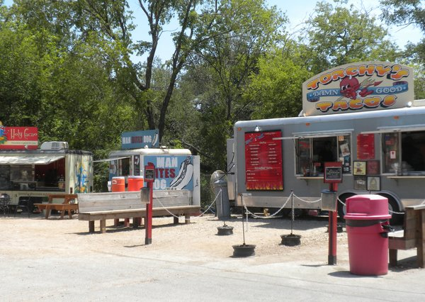 Parked for lunch were Torchy's Tacos, Man Bites Dog, and Holy Cacao.