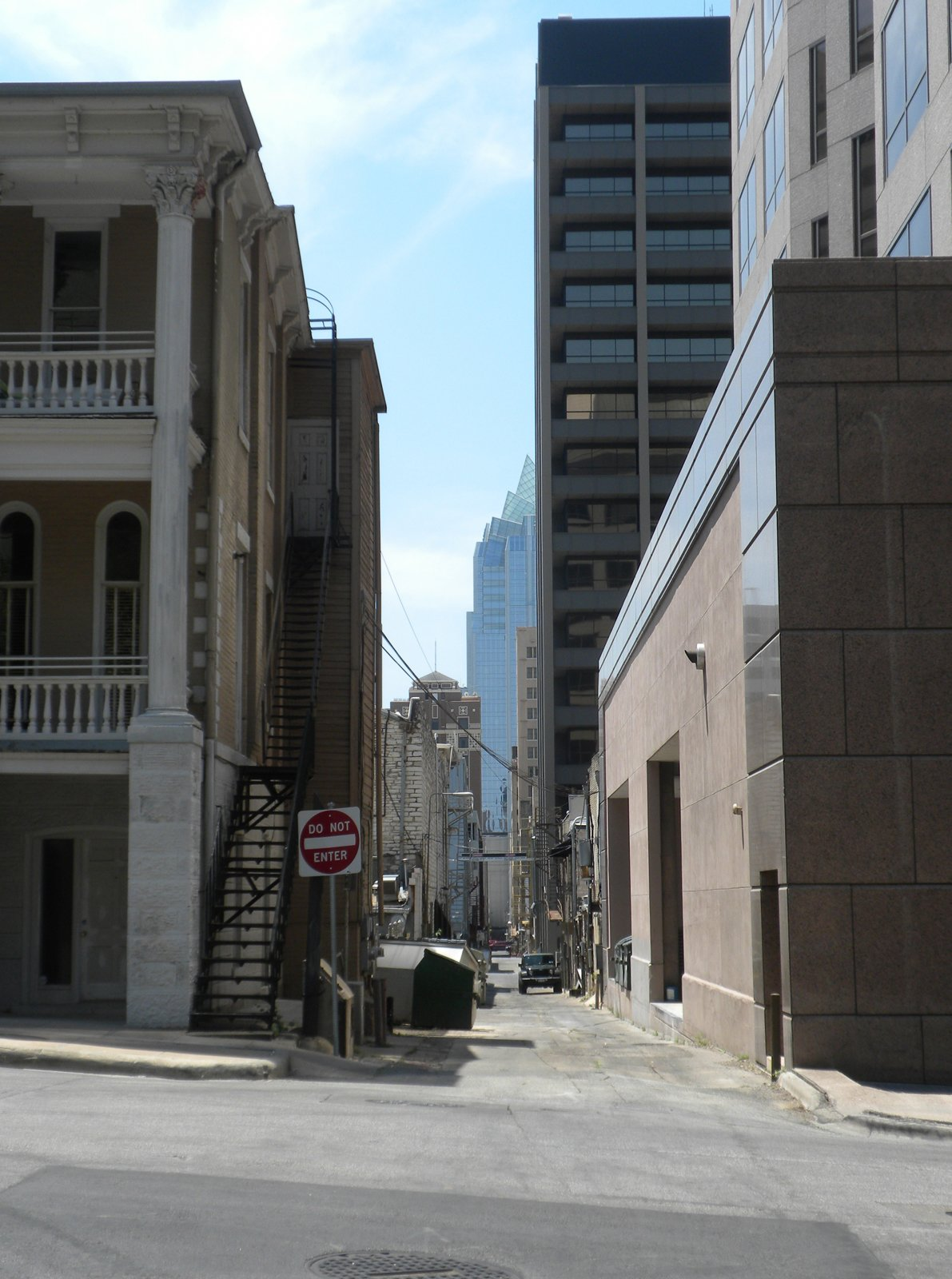 To find some shade, we walked down some of Austin's narrow downtown alleys. In the distance is the Frost Bank Tower.  Three Days in Austin, Texas by Miyoko Ohtake