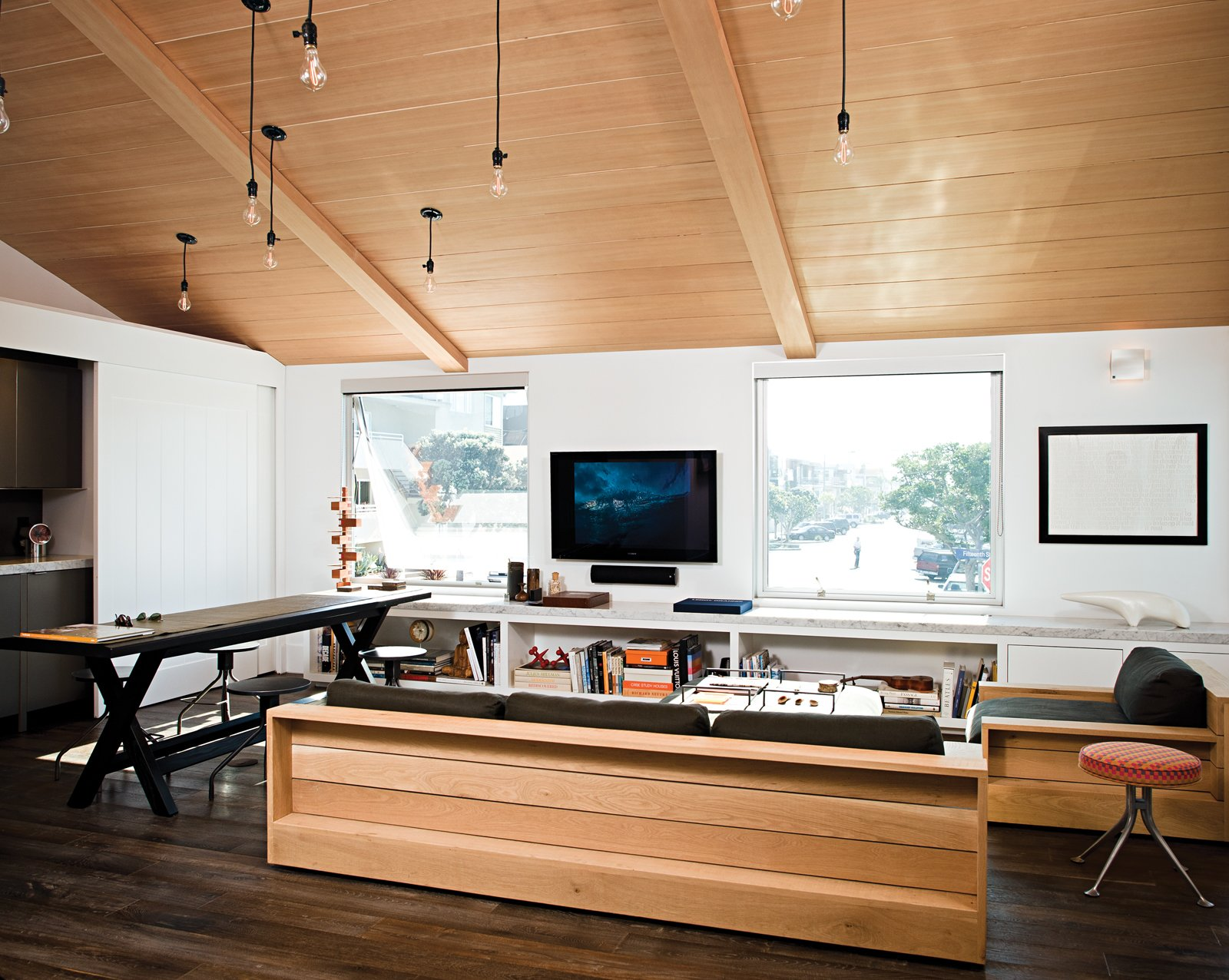 Living Room, Sofa, and Dark Hardwood Floor The Marmol Radziner–designed James Perse showroom in Malibu provided aesthetic inspiration for Jacobson, who outfitted his place with furnishings from the brand.  Photo 5 of 18 in Less is More in this Manhattan Beach Bungalow