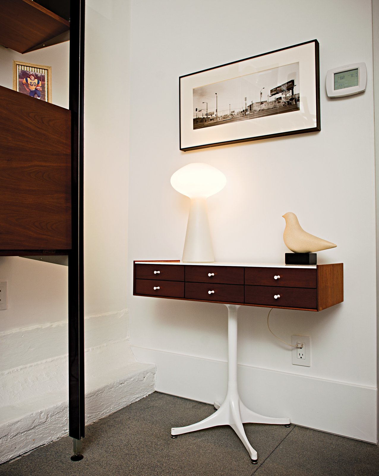 A Nelson jewelry cabinet and Massimo Vignelli lamp.  Photo 9 of 18 in Less is More in this Manhattan Beach Bungalow