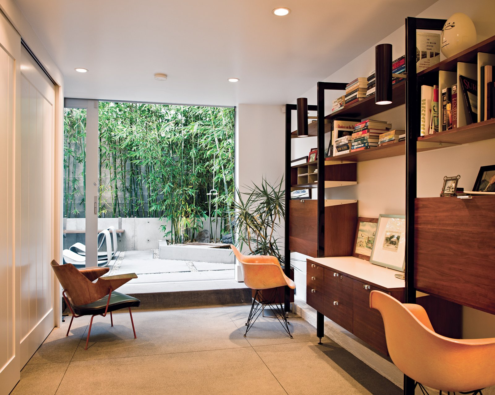 Office, Study Room Type, Desk, and Chair A bentwood Robin Day chair keeps the Herman Miller classics company. Through the office's door, nestled in the bamboo grove, is an outdoor shower, fashioned after those found in San Onofre, farther south.  Photo 11 of 18 in Less is More in this Manhattan Beach Bungalow