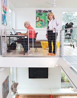 This couple makes good use of limited space by using the front loft of their weekend home for both work and play.