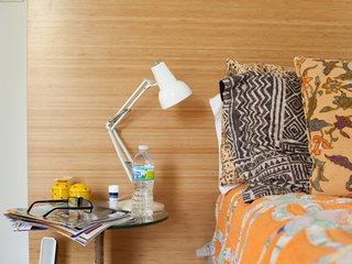 Church and Jett's bed is splashed with eclectic textiles and linens.