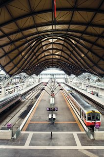 On the other end of the high-design, high-budget spectrum, Southern Cross Station designed by Grimshaw Architects, is all swooping roofs and open space. Rather a nice spot to get stuck should your train run late.