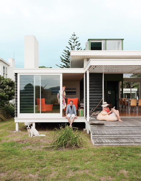 Fed up with flashy, environmentally insensitive beach homes, architect Gerald Parsonson and his wife, Kate, designed a humble hideaway nestled behind sand dunes along the New Zealand coastline. Crafted in the image of a modest Kiwi bach, their 1,670-square-foot retreat consists of a group of small buildings clad in black-stained pine weatherboards and fiber-cement sheets.