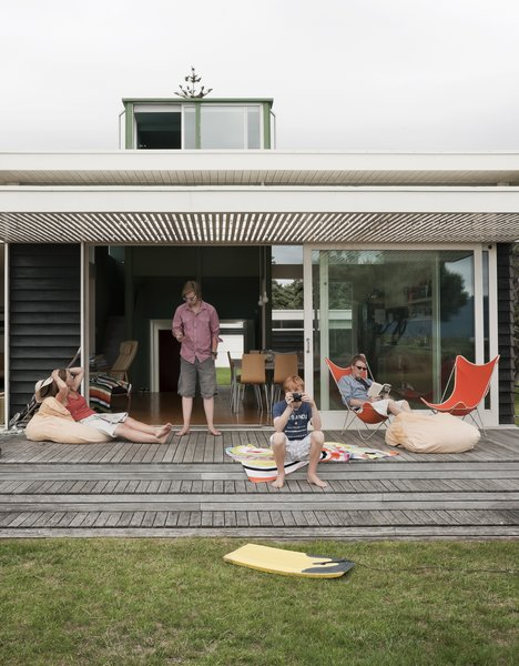 The family spends summers and school vacations at the bach. New Zealand's relatively mild winters mean they use the house year-round.