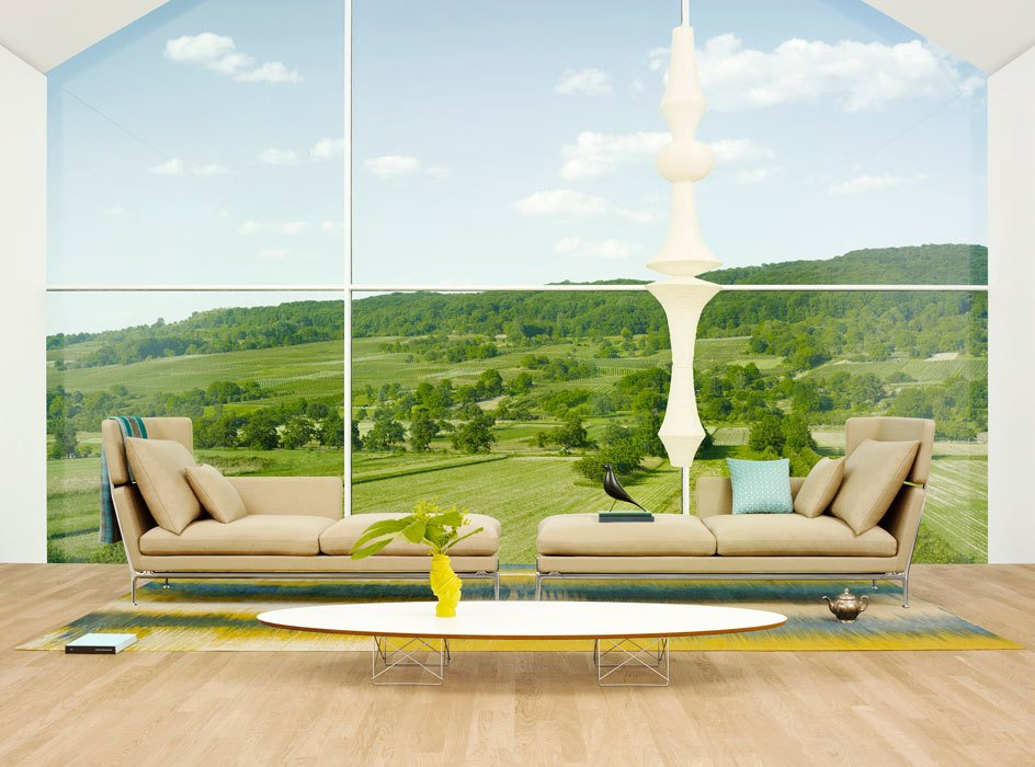 The ideal setup for a long wall of windows: a chaise shape with headrest.  Photo 6 of 7 in Suita Sofa by Antonio Citterio