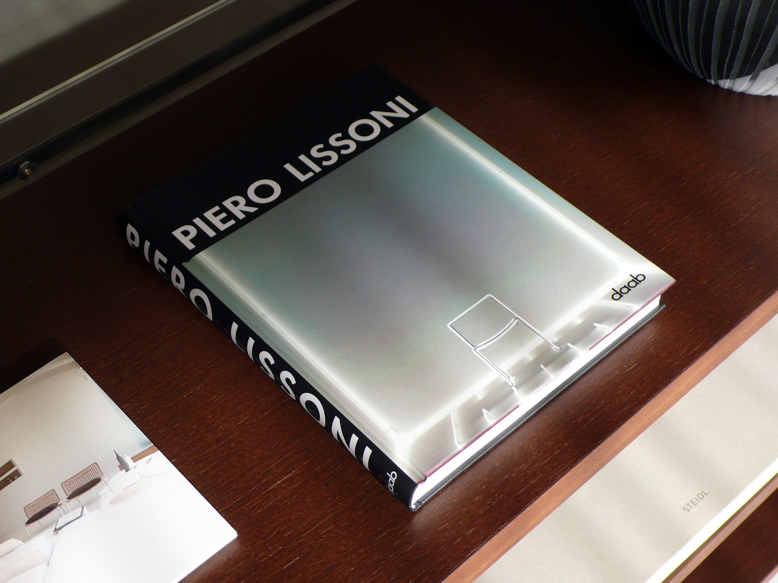 A book of Lissoni's designs from daab rests on a shelf in his System NXT.  Photo 2 of 7 in 10 Minutes With Piero Lissoni