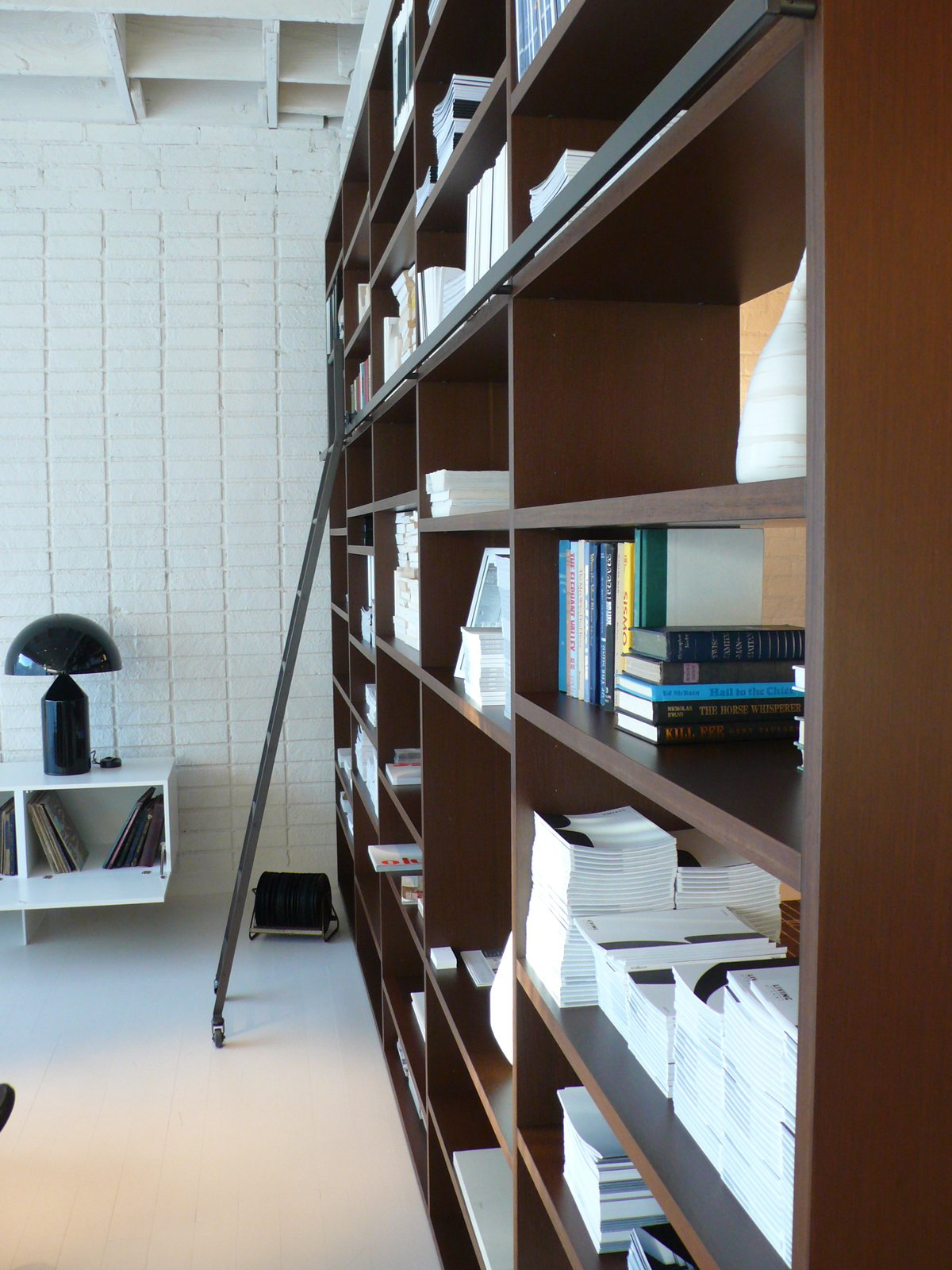 The showroom's System NXT is outfitted with a library ladder and a multitude of design books.  Photo 7 of 7 in 10 Minutes With Piero Lissoni