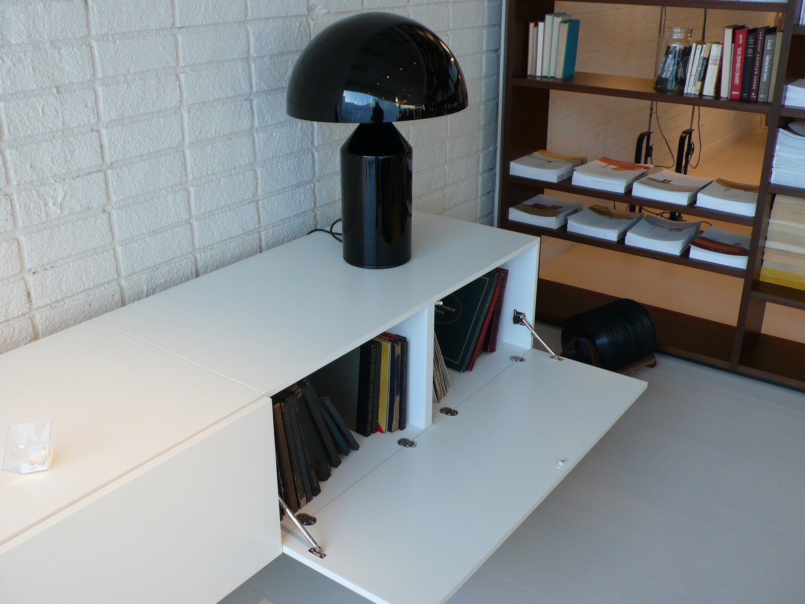 A low storage unit holds boxed LPs and an Atollo lamp by Oluce.  Photo 5 of 7 in 10 Minutes With Piero Lissoni