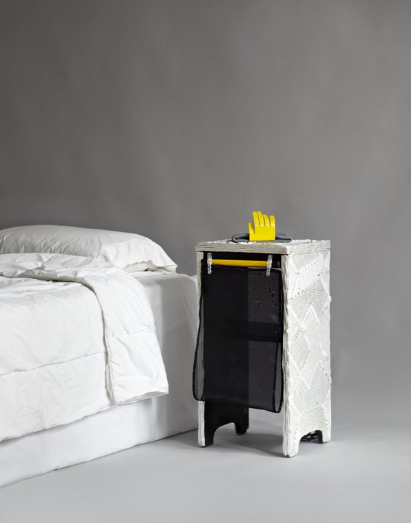 A mixed-media nightstand by Paul Kopkau has a surrealist look about it.  The Nightstand, Reinvented by Jaime Gillin