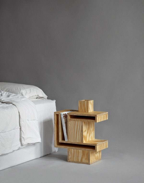 RO/LU's cubist plywood nightstand was inspired by an Ettore Sottsass cabinet discovered online. The slots are intended to store magazines.  The Nightstand, Reinvented by Jaime Gillin