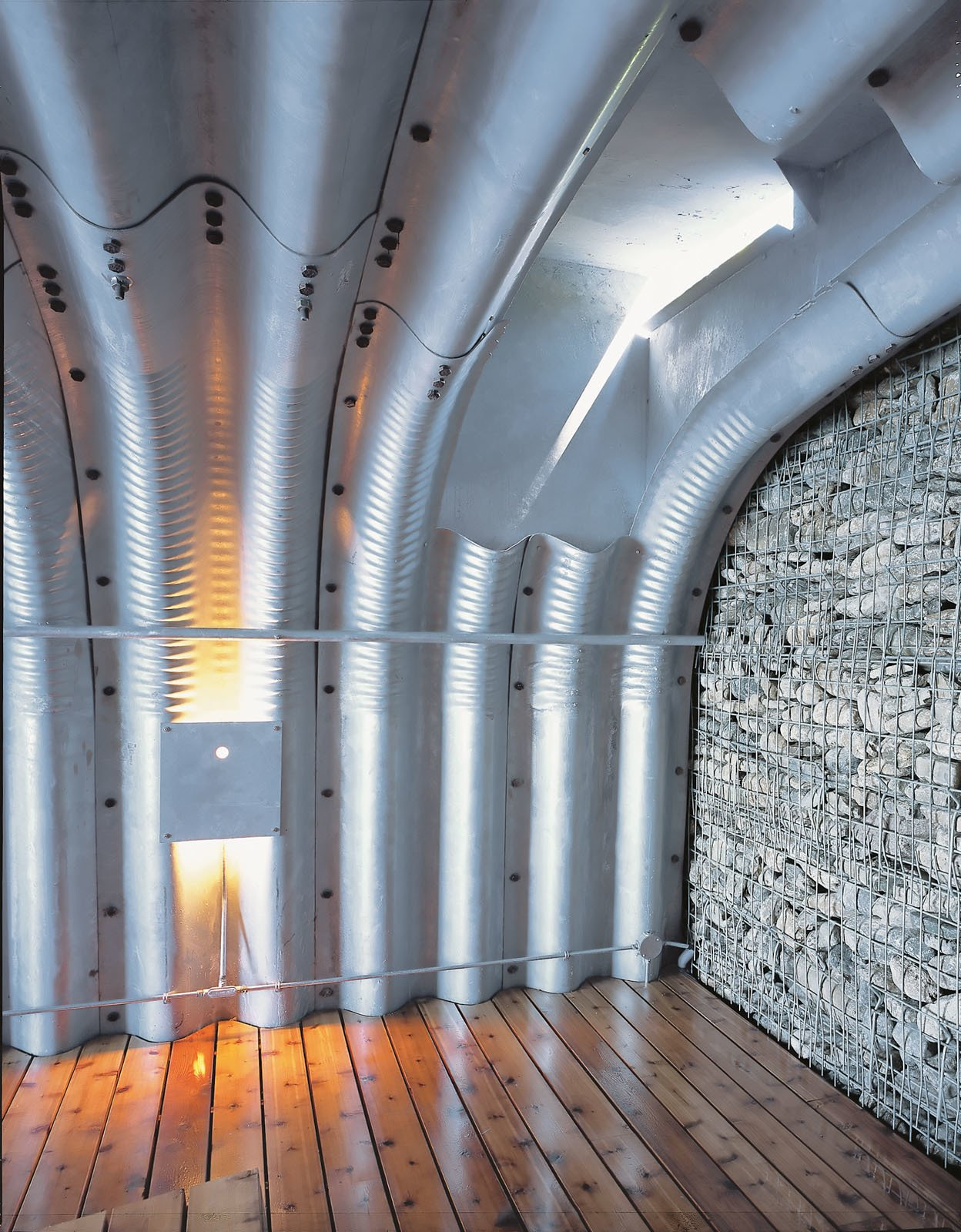 """Being inside the boathouse, with its deep corrugations, is a unique experience. """"You feel like you're in an upside-down boat or in a whale's body,"""" Adam says. """"It's quite beautiful.""""  Search """"arch support"""" from About a Boat"""