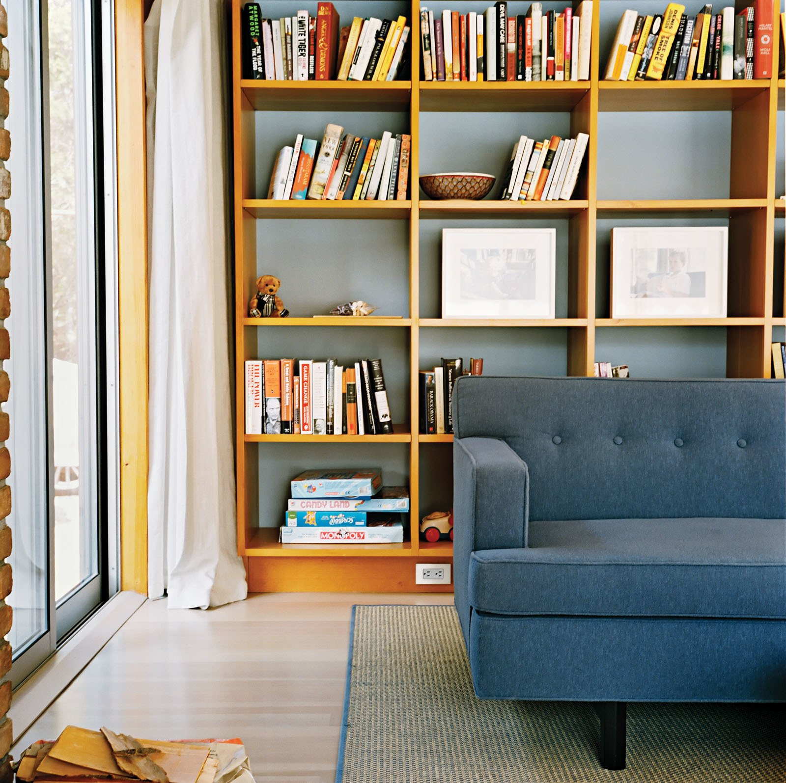 Living Room, Sofa, Bookcase, and Rug Floor In the living room, a warm woodsy palette reigns, with a few blue-gray notes to create a serene mood.  Tips for Creating a Comfortable Living Room by Drew McGukin from Long Island Found