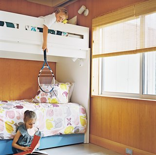 Henry and Emily share a bedroom and a bunkbed made by Ducduc, an American furniture company. Thanks to panel doors that slide into the walls, the bedrooms balance privacy with openness to the rest of the house. With a guestroom and trundle beds in the kids' rooms, the 1,357-square-foot house can easily sleep four adults and five children—more if people crash on the couches.