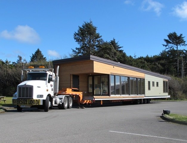 """A Balance Large module makes its way to its site on the Washington coast.  Search """"light filled metallic home embraces its wooded site"""" from Mark Rylant of Method Homes"""