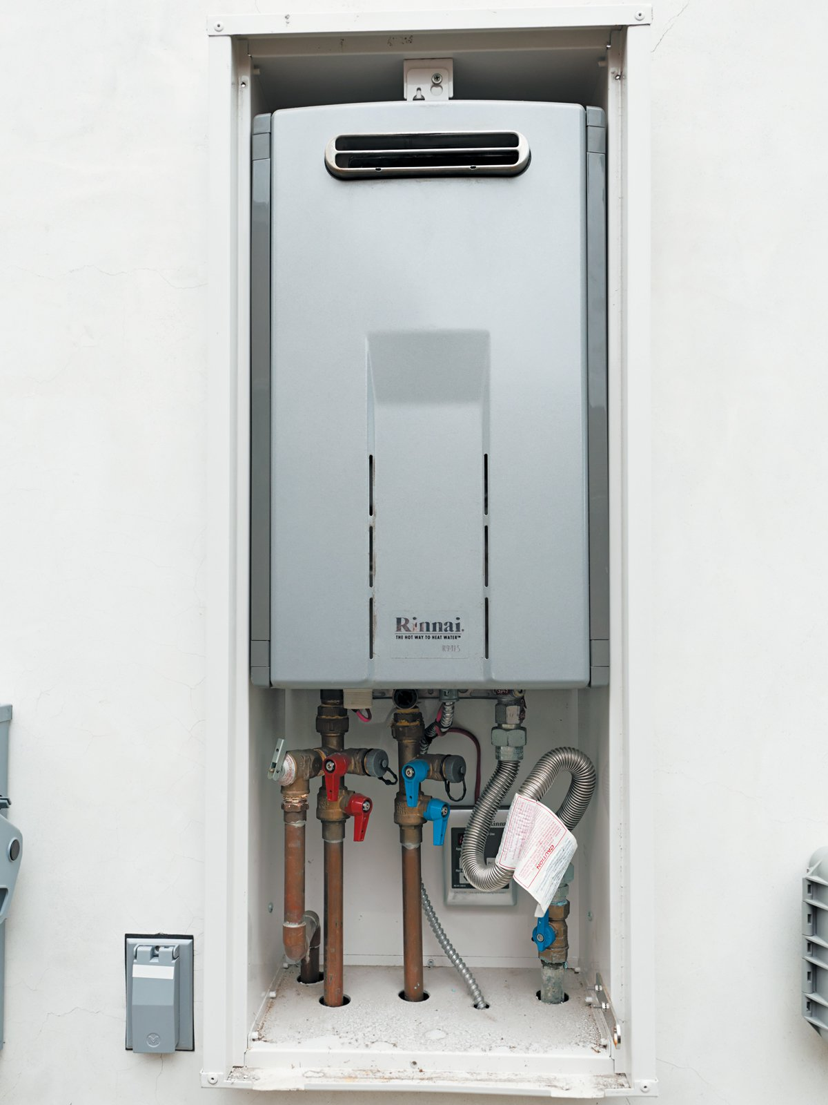 To avoid running the tap—and pouring water and money down the drain—the Lais installed a Rinnai tankless water heater and Metlund D'MAND recirculating pump for near-instant hot water. When David or Mayuko enter the Miele-outfitted kitchen, a sensor triggers the systems, readying the water to flow out of the faucets at piping-hot temperatures four to five times more quickly than without the setup.  Photo 2 of 13 in A Dream House for the Ages