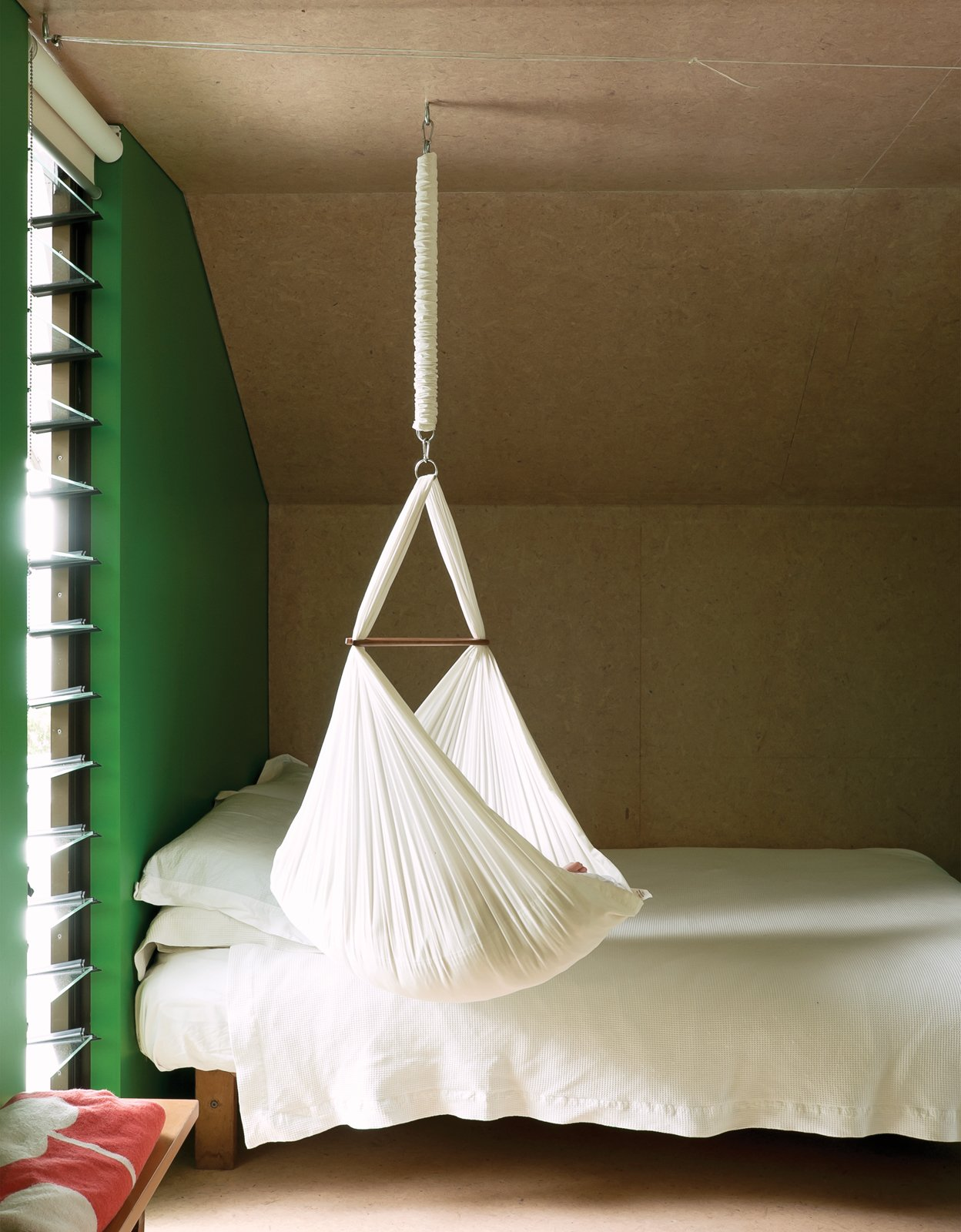 Bedroom and Bed For now, one-year-old Awa is small enough to sleep in the hammock that hangs from the ceiling.  Bedrooms by Dwell from Make Your Parents Happy by Building Them a House