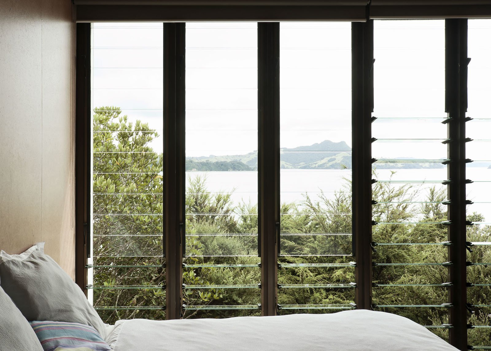 Living so near the water the views, especially through these louvered windows, out to Maramaratotara Bay are spectacular.  Photo 1 of 16 in 5 Energy-Efficient and Stylish Ways to Shade Your Windows from Make Your Parents Happy by Building Them a House