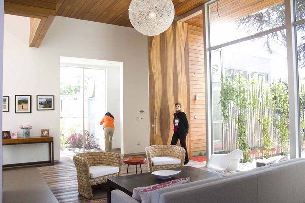 The 4,500-square-foot, six-bedroom, two-story home has multiple living areas rendered in a neutral color palette and punched up with bright color.