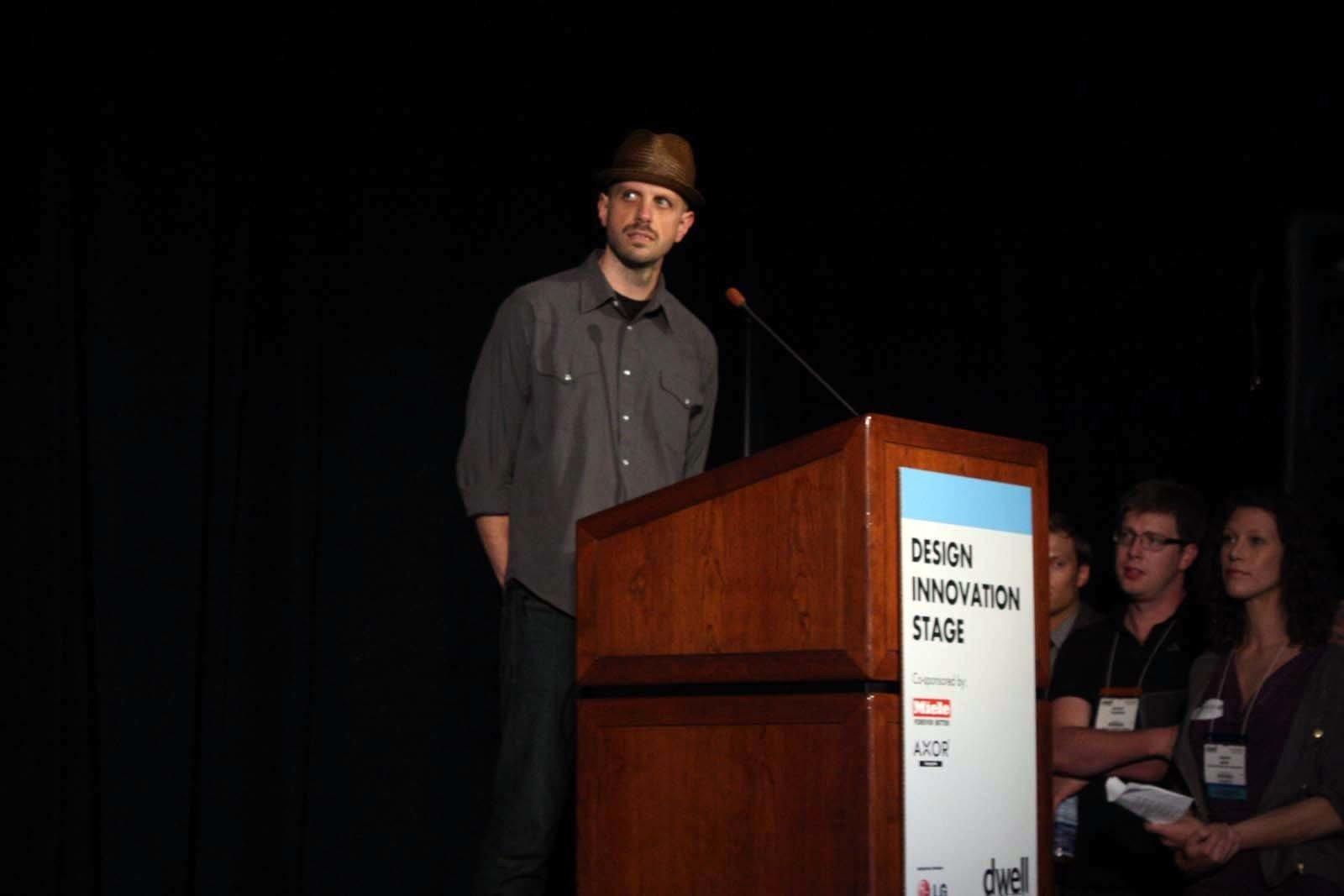 Tom De Blasis presents the Gamechanger Bucket.  Photo 1 of 7 in From the Show Floor: Pecha Kucha