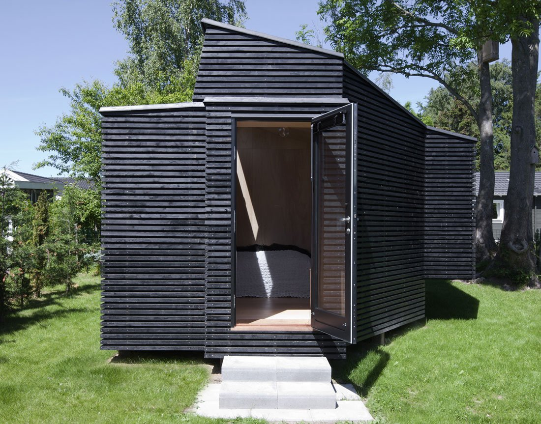 Exterior, Tiny Home Building Type, Cabin Building Type, and Wood Siding Material The design eschews right angles on the exterior and interior, which was one of the most challenging aspects of the design for Kallesø.  Modern Danish Homes We Love from Guesthouse in Præstø, Denmark
