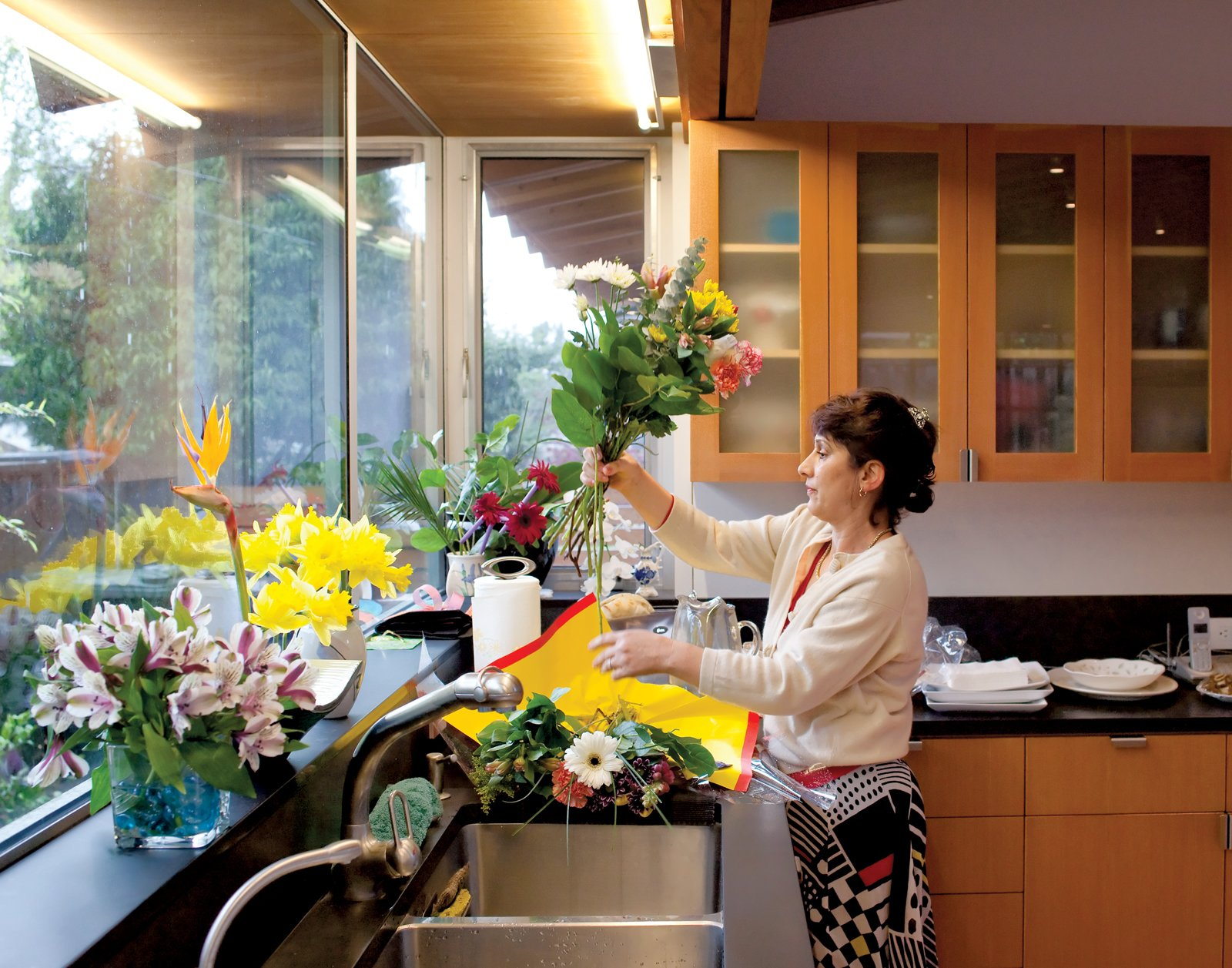 Kitchen and Wood Cabinet Fashandi arranges flowers and greenery for Persian New Year, which is a celebration of spring.  Photo 1 of 13 in 15 Flower Arrangements That Will Brighten Your Home on Valentine's Day from Family Matters