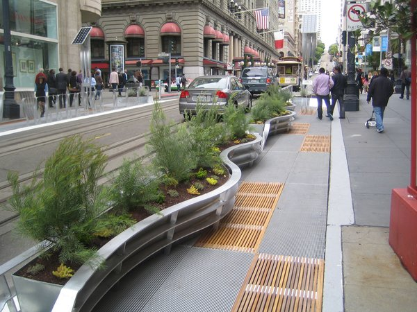 There are eight parklet sections over the two blocks of Powell St. just north of the famous cable car turnaround. The street is a popular shopping district just south of Union Square that is routinely mobbed by locals and tourists alike. Undoubtedly the widening of the sidewalks, and narrowing of the street, will cause some growing pains, but as an investment in the pedestrian streetscape, this is a wonderful step.