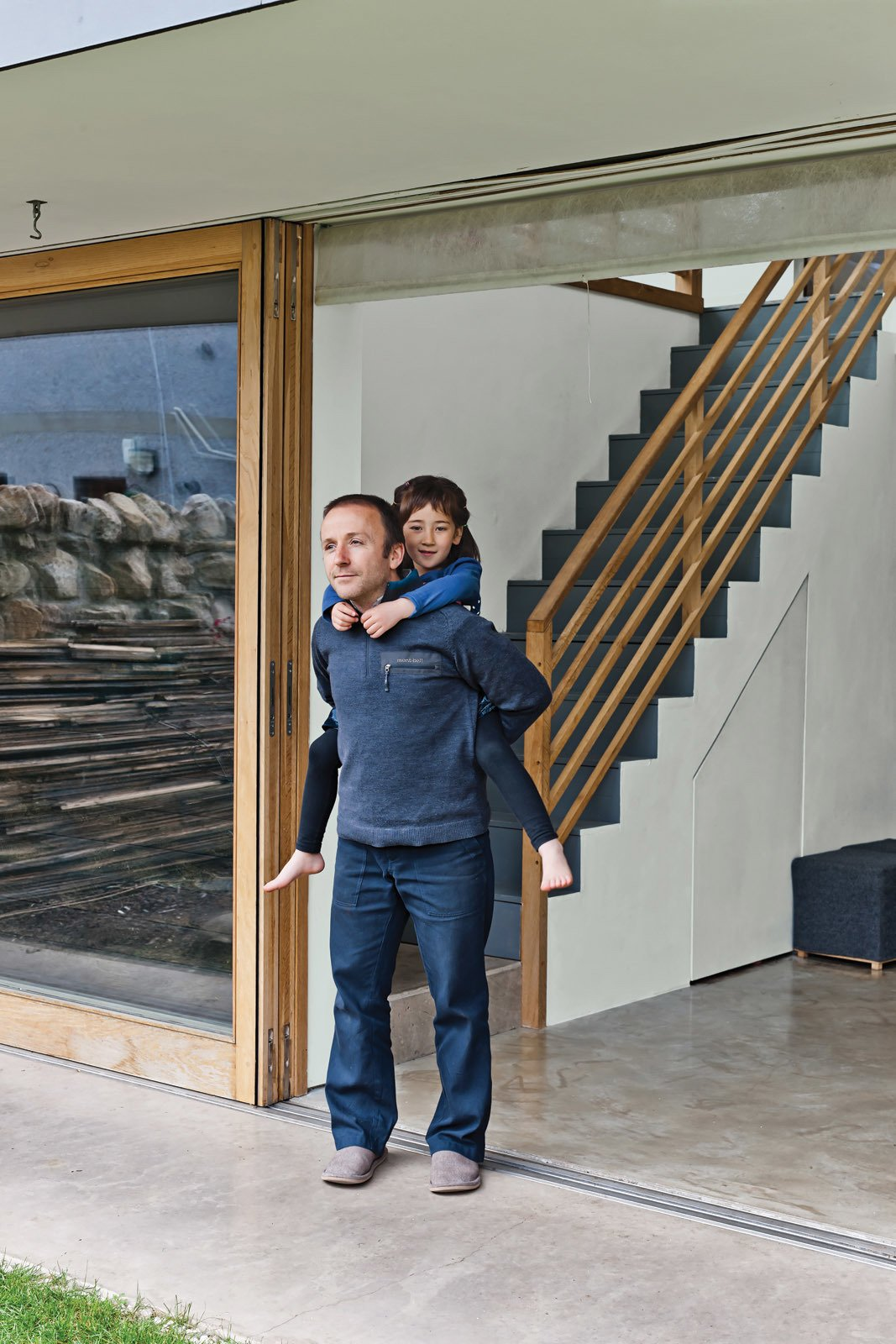 Gaffney and Kiku take in the air from the large sliding door bought from Timber Tech Scotland. Tagged: Staircase, Wood Tread, and Wood Railing.  190+ Best Modern Staircase Ideas from A Piece of Home