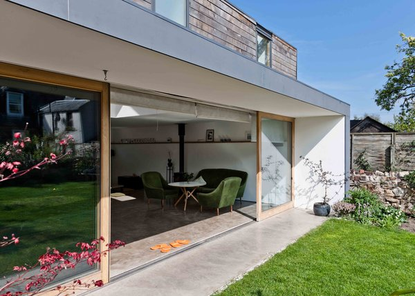 The nuri-en (an exterior overhang) is one of the few Japanese touches on the home's exterior. Paired with the continuation of the interior floor right out into the backyard, the home opens up to the outside quite nicely.