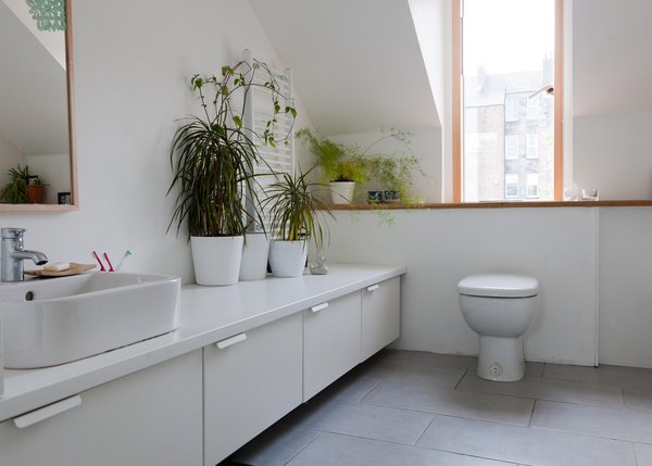 Though most of the home's interior comes without a splashy designer's name attached, the bathroom is kitted out with a toilet, sink, and bath/shower from Jasper Morrison's line for Ideal Standard. The cabinets are from an Ikea kitchen system.