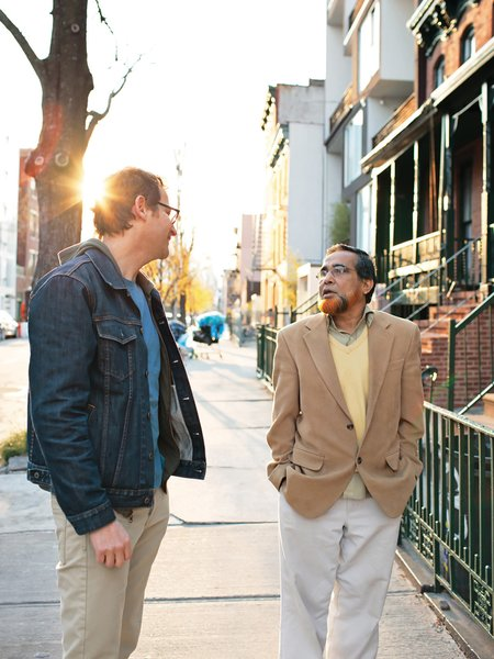 Sherman chats with his neighbor Sakhawat Ullah, the mason who built his front stoop.