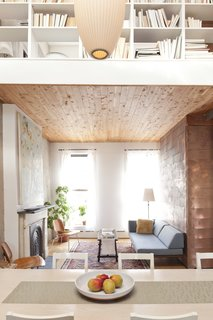 """Now You Cedar  To make sure the light well over the dining area read as """"a hole, rather than just a bending of the Sheetrock plane,"""" Sherman clad the first-floor ceiling in inexpensive tongue-and-groove cedar closet liner from Home Depot. Bonus: """"I like the smell of cedar,"""" says Sherman, and now the house carries a faintly woodsy scent."""